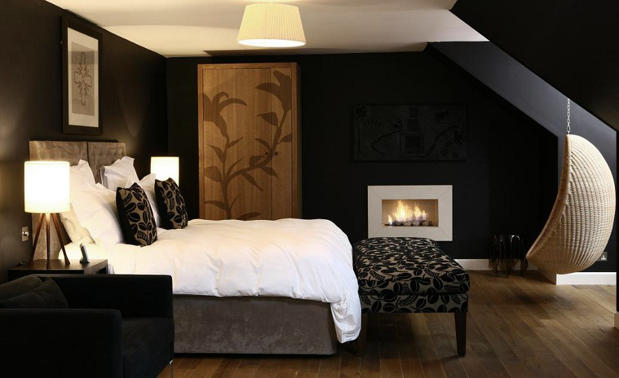 Black Bedroom with Decorative Fireplace
