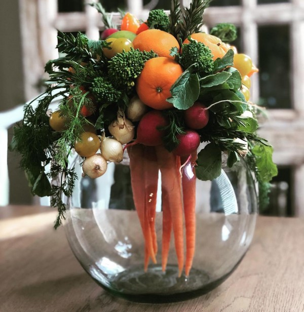 You have to see this #Easter centerpiece idea with a bowl of veggies and fruit. Love it! #HomeDecorIdeas @istandarddesign