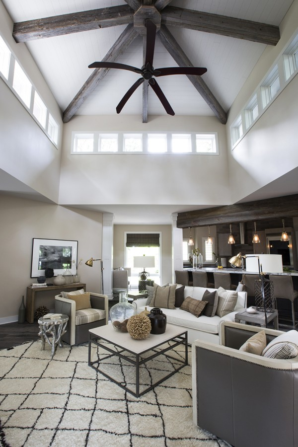 living room with vaulted ceiling, wood beams