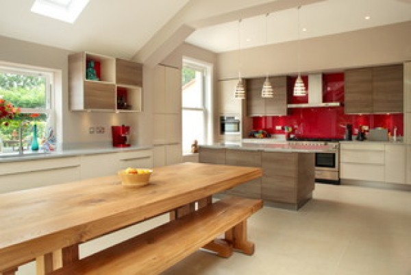 Contemporary kitchen with red splashback and vaulted ceiling