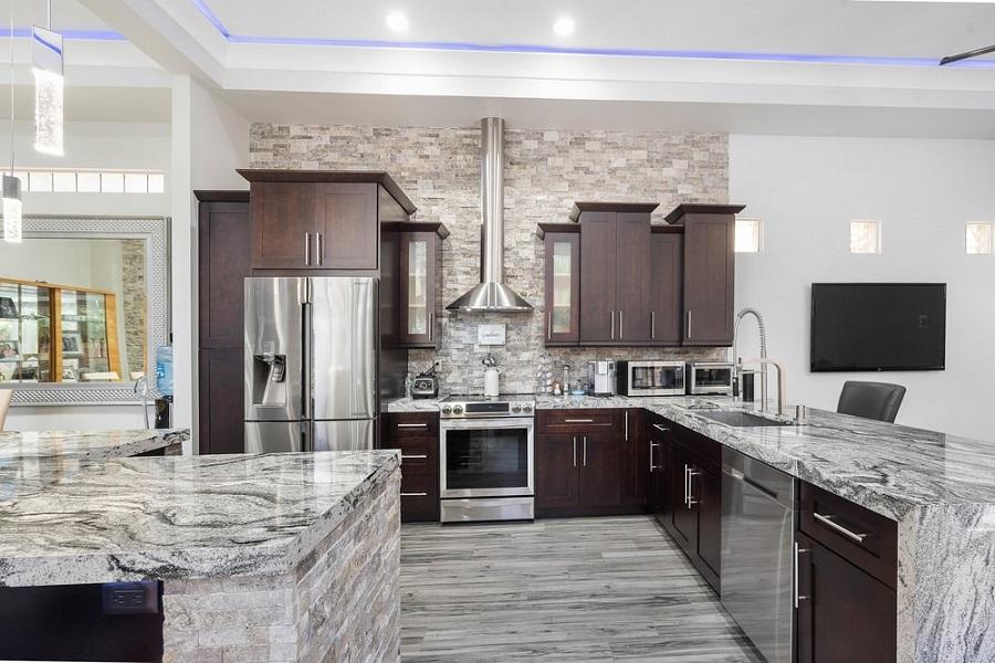 granite countertops with dark kitchen cabinets