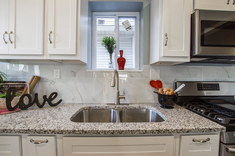 granite countertops with stainless steel hardware