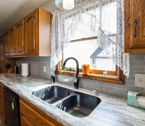granite countertops with natural wood cabinets