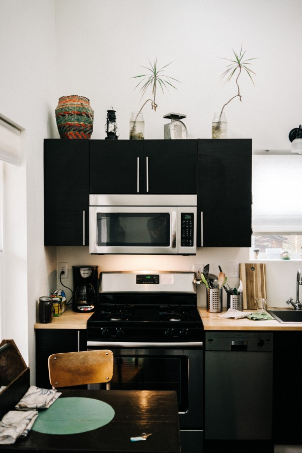 Wooden Countertops and Black Cupboards