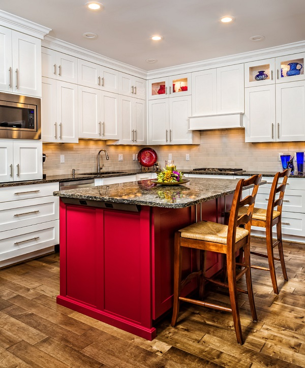 White shaker cabinets with a red kitchen island